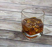 Closeup of a glass of whisky with ice cubes Stock Images
