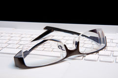 Closeup Glasses on a Keyboard royalty free stock photography