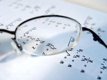 Closeup of Glasses Len. Which helps focus the words on the page Royalty Free Stock Photo