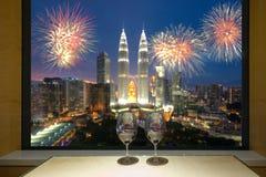 Closeup of a glasses of red wine at windowsill, against night Ku Stock Image