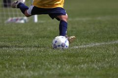 Closeup Goalie Kick. Closeup of a girls soccer goalie kicking the ball Royalty Free Stock Images