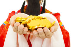 Closeup of  God of wealth holding gold coin. Stock Photos