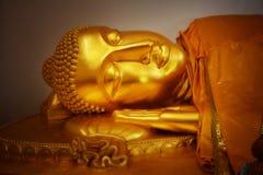Closeup Gold Buddha. The face of Sleeping Buddha Stock Image
