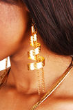 Closeup of gold earring. Royalty Free Stock Photos