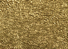 Closeup gold foil surface Royalty Free Stock Photography