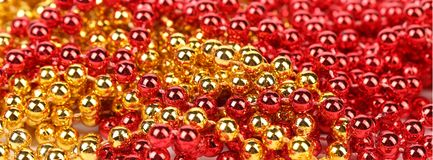 Closeup of gold and red beads. Stock Photos