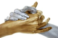 Closeup of gold and silver hands royalty free stock image