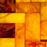 Closeup of golden amber mosaic as background or texture. Gem. Royalty Free Stock Photos