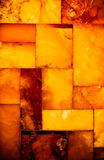 Closeup of golden amber mosaic as background or texture. Gem. Stock Photography