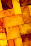 Closeup of golden amber mosaic as background or texture. Gem. Royalty Free Stock Images