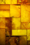 Closeup of golden amber mosaic as background or texture. Gem. Royalty Free Stock Photo