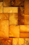 Closeup of golden amber mosaic as background or texture. Gem. Royalty Free Stock Photography