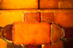 Closeup of golden amber mosaic as background or texture. Gem. Stock Image