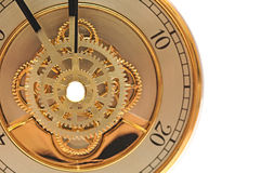 Closeup golden clock with gears. On white Royalty Free Stock Photo