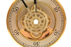 Closeup golden clock with gears. On white Stock Image
