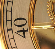 Closeup golden clock with gears Stock Photo