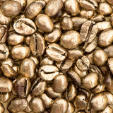 Closeup of golden coffee beans. food and beverages Royalty Free Stock Photo