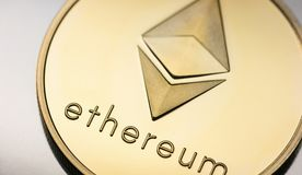 Golden Ethereum coin Cryptocurrency stock photo
