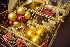 Box with colorful Christmas decorations close up royalty free stock image