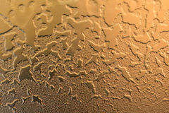 Closeup of golden textured grunge background Stock Images