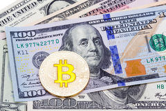 Closeup of golden yellow bitcoin on hundred dollars banknote, ma. Cro shot. High resolution photo Royalty Free Stock Images