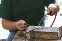 Closeup of goldsmith working. In one piece stock photography