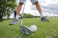 Closeup golfer preparing to hit golfball Royalty Free Stock Photo