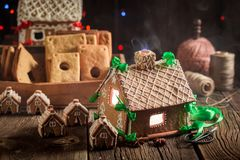 Gorgeous Christmas gingerbread cottage in the old workshop Stock Photo