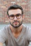 Closeup of gorgeous man wearing eyeglasses royalty free stock photos