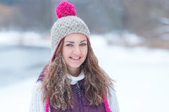 Closeup of a gorgeous winter smiling woman Stock Photography