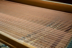 Closeup of grand piano showing the strings, pegs and sound board Royalty Free Stock Photo
