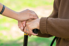 Closeup grandmother granddaughter holding hands Royalty Free Stock Photography