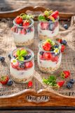 Granola with berries and yoghurt in jar. Closeup of granola with berries and yoghurt in jar royalty free stock photo