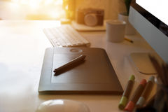 Closeup of a graphic designer`s desk. Workspace creative digital tablet and modern desktop computer Stock Photography