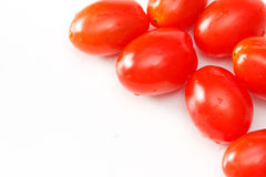 Grape tomatoes. Closeup of grappe tomatoes on white background Royalty Free Stock Image