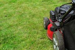 Closeup of grassmower mowing the grass Stock Image