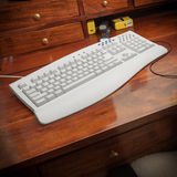 Closeup of gray computer keyboard on wooden desk Royalty Free Stock Photos