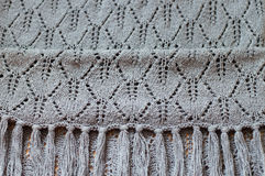 Closeup on gray detail of woven handicraft knit shawl Stock Photo