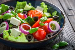 Closeup of Greek salad with feta cheese and black olives Stock Photos