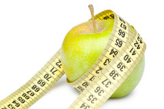 Closeup of a green apple with a measuring tape Stock Image