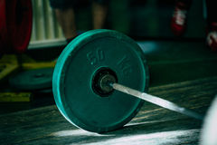 Closeup of green barbell plates Royalty Free Stock Images