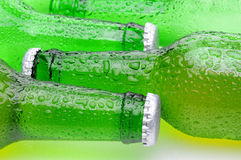 Closeup of Green Beer Bottles Laying on Their Side Royalty Free Stock Photos