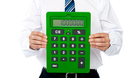Closeup of a green calculator. Man holding it Stock Photography