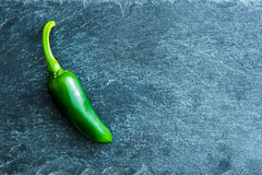 Closeup on green chili pepper on stone substrate Stock Photo