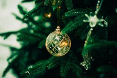 Closeup of Green Christmas tree and pink ball decorations. Closeup of Green Christmas tree and ball decorations Royalty Free Stock Photo