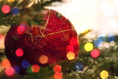 Closeup of Green Christmas tree and red vintage ball decorations Royalty Free Stock Image