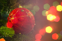 Closeup of Green Christmas tree and red vintage ball decorations Royalty Free Stock Photography