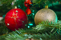 Closeup of Green Christmas tree and red vintage ball decorations Royalty Free Stock Photos