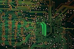 Closeup of Green Electronic circuit board. background Stock Image