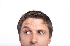 Closeup of a green eyed man raising eyebrow Royalty Free Stock Photography